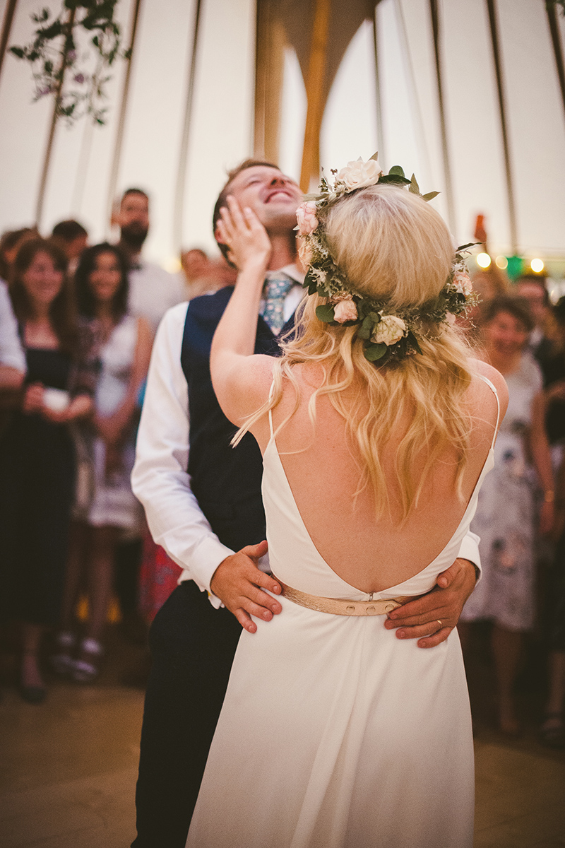 wedding couple first dance bride holds grooms face